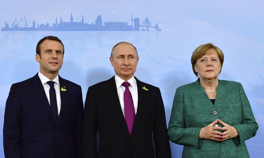 Путин, Меркель и Макрон обсудили пути урегулирования конфликта на Украине